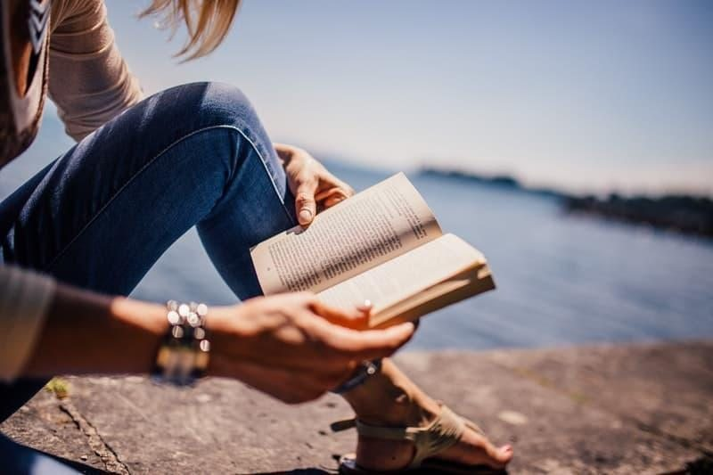 reading beach sun woman