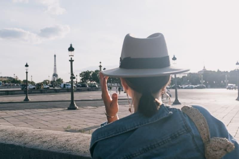 woman in denim jacket and hat