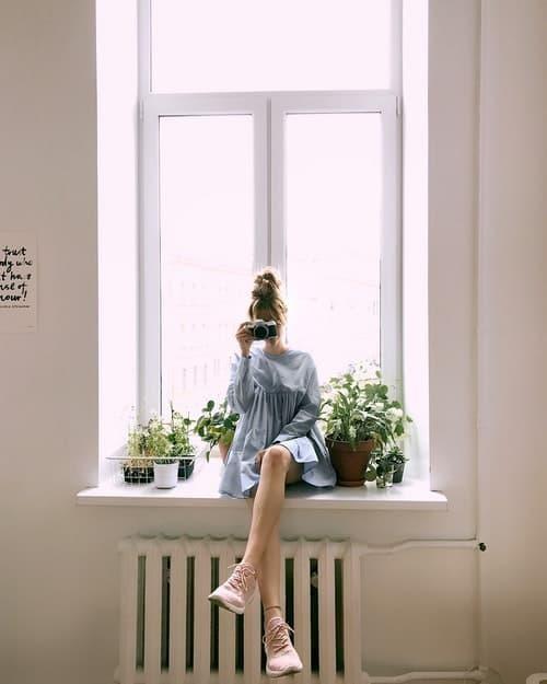 parisian parizyen woman in blue dress on the window